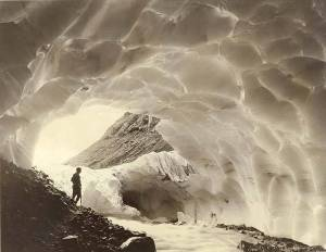 Mountaineer in one of the ice caves of Paradise Glacier, Mount Rainier National Park, Washington, CA. 1925. University of Washington, Commons.